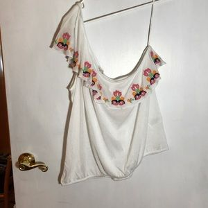 White one shoulder shirt.